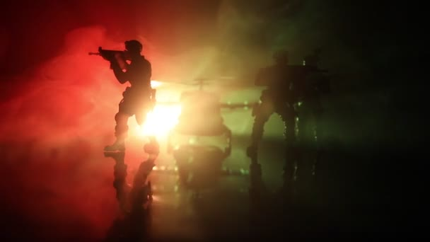 Silhouette of military helicopter ready to fly from conflict zone. Decorated night footage with helicopter starting in desert with foggy toned backlit. Selective focus.