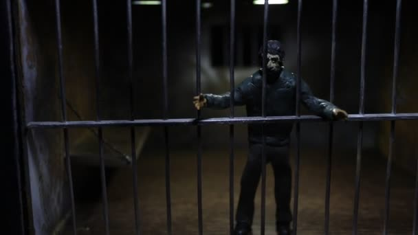 close-up footage of miniature toy jail cage under mystic light