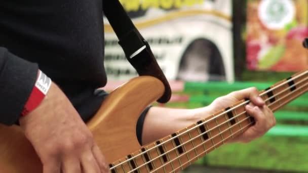 Musician plays bass guitar