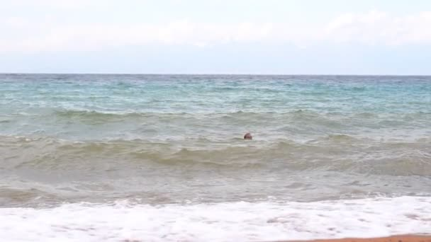 a man swimming in the sea