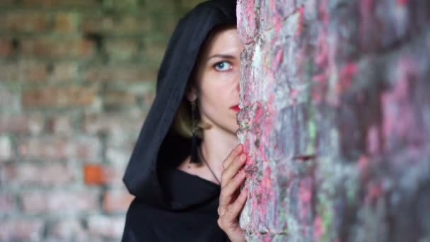 girl in a black cloak in the wreck