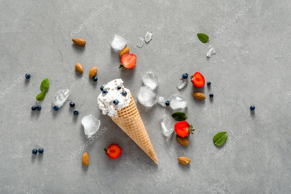 Scoop of ice cream in cone, top view