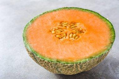 Half of melons, orange cantaloupe melon slice