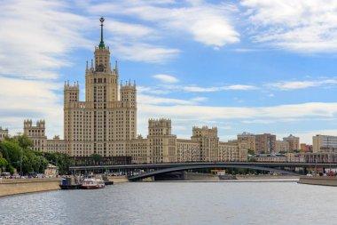 Moscow, Russia - June 21, 2018: View of Bolshoy Ustyinskiy bridge on a background of skyscraper on Kotelnicheskaya embankment on a sunny summer morning