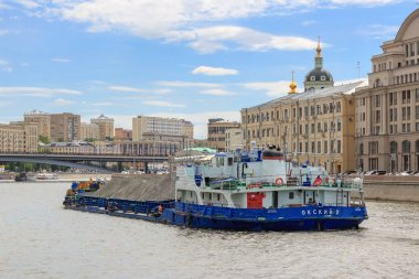 Moscow, Russia - June 21, 2018: Loaded barge floating in the center of Moscow on Moskva river