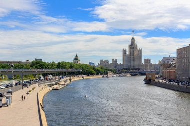 Moscow, Russia - June 21, 2018: Moskvoretskaya embankment in Moscow against skyscraper on Kotelnicheskaya embankment on a sunny summer morning