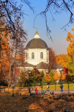 Moscow, Russia - October 17, 2018: Church of the icon of the mother of God in Tsaritsyno park in Moscow on a background of trees with colored leaves at sunny autumn day