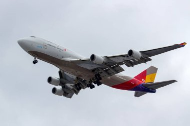 Moscow, Russia - March 17, 2019: Aircraft Boeing 747-48E(BDSF) HL7413 of Asiana Airlines going to landing at Domodedovo international airport in Moscow against gray sky on a cloudy day