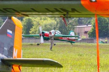 Balashikha, Moscow region, Russia - May 25, 2019: Russian aerobatic aircraft Yakovlev YAK-55M RA-2935G landing on Chyornoe airfield at Aviation festival Sky Theory and Practice 2019