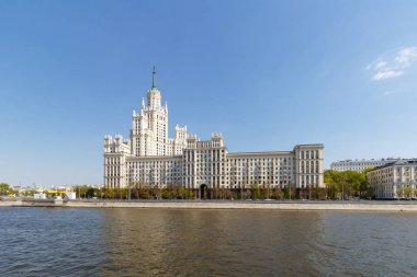Moscow, Russia - May 01, 2019: High-rise on Kotelnicheskaya embankment in Moscow against Moskva river in sunny spring morning