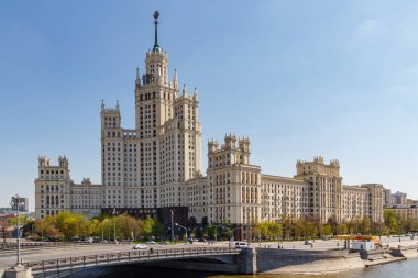 Moscow, Russia - May 01, 2019: Malyi Ustyinskiy Bridge above Yauza river and Stalin skyscraper on Kotelnicheskaya Embankment in Moscow at sunny spring morning
