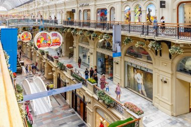 Moscow, Russia - July 28, 2019: Visitors on alleys against storefronts in GUM State Department Store. GUM on Red square in Moscow is popular touristic place