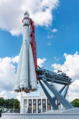Moscow, Russia - July 22, 2019: Space rocket Vostok against blue sky with white clouds in VDNH park in Moscow at sunny summer day. VDNH park is popular touristic landmark