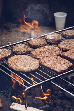 Close-up of delicious hamburger meat being grilled on barbecue outdoors