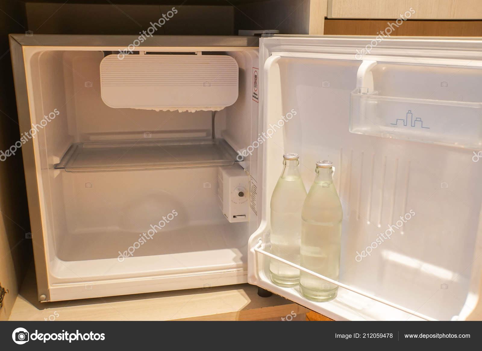 . Mini Fridge Hotel Bedroom Fresh Water Bottle   Stock Photo   Jummie