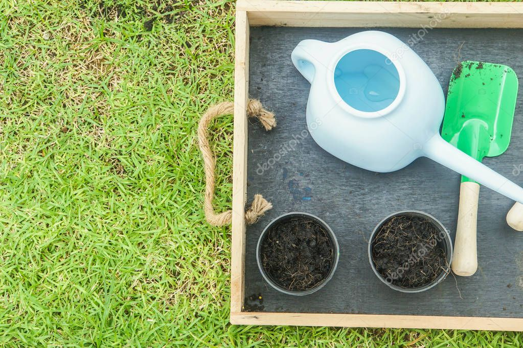 close up top view of cultivation tools with flower pot for gardening at home in holidays