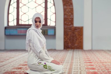 Young beautiful Muslim Woman Praying In Mosque