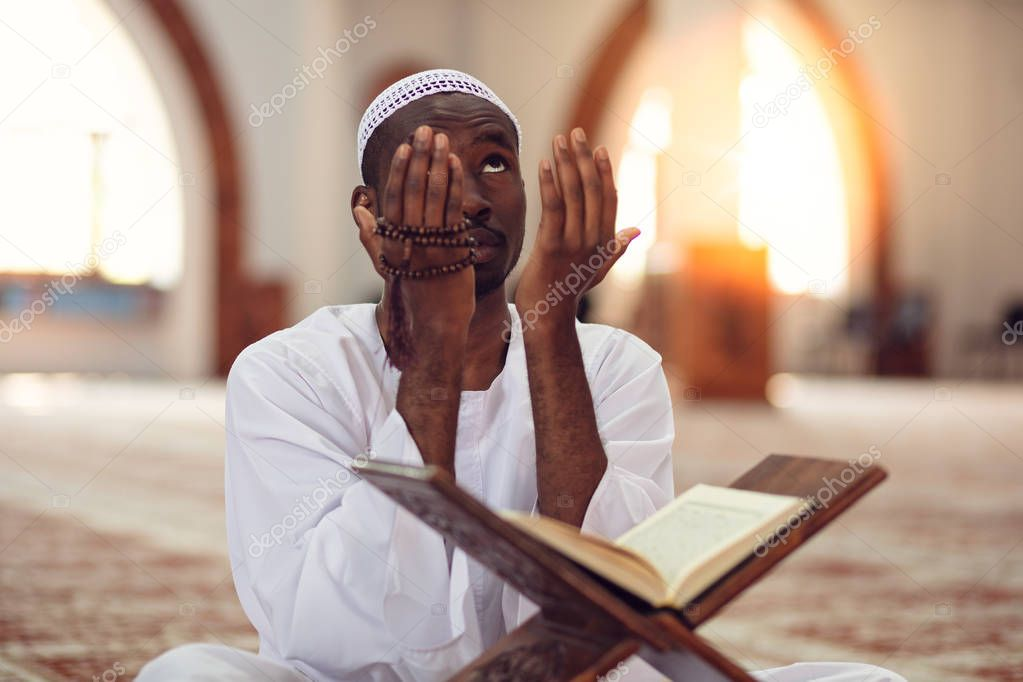 African Muslim Man Making Traditional Prayer To God While Wearing Dishdasha. stock vector