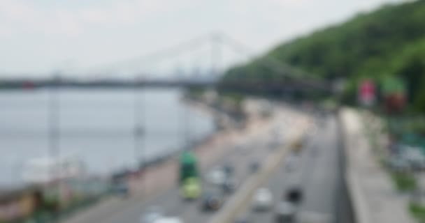 Panorama with a view of the bridge, water, water transport, city cars in blur bokeh reflexes, blurred silhouettes, daylight, travel