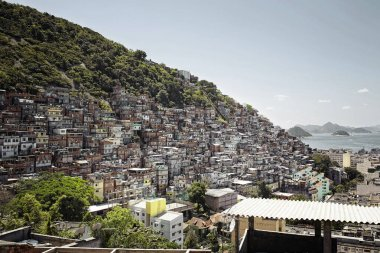 Houses stand on a hill in the Rocinha slum of Rio de Janeiro, Brazil