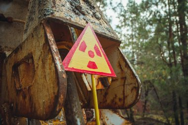 Radiation Sign - triangular warning yellow sign of radiation hazard in the zone of radioactive fallout in Pripyat city. Chernobyl exclusion zone