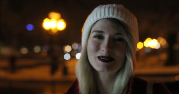Portrait of a beautiful girl. gorgeous girl, portrait in night city lights. Vogue fashion style portrait of young pretty beautiful woman. Model looking at camera, wearing hat