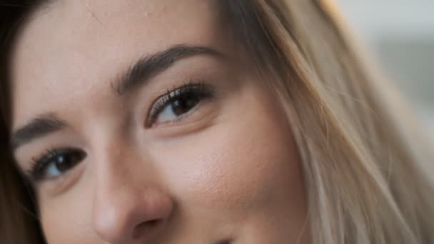 Close up portrait of beauty young beautiful womans eyes, smiling looking at camera Eyes of woman face, beautiful woman girl blonde female portrait model.