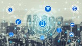 Fotografie Smart city wireless communication network with graphic showing concept of internet of things ( IOT ) and information communication technology ( ICT ) against modern city buildings in the background.