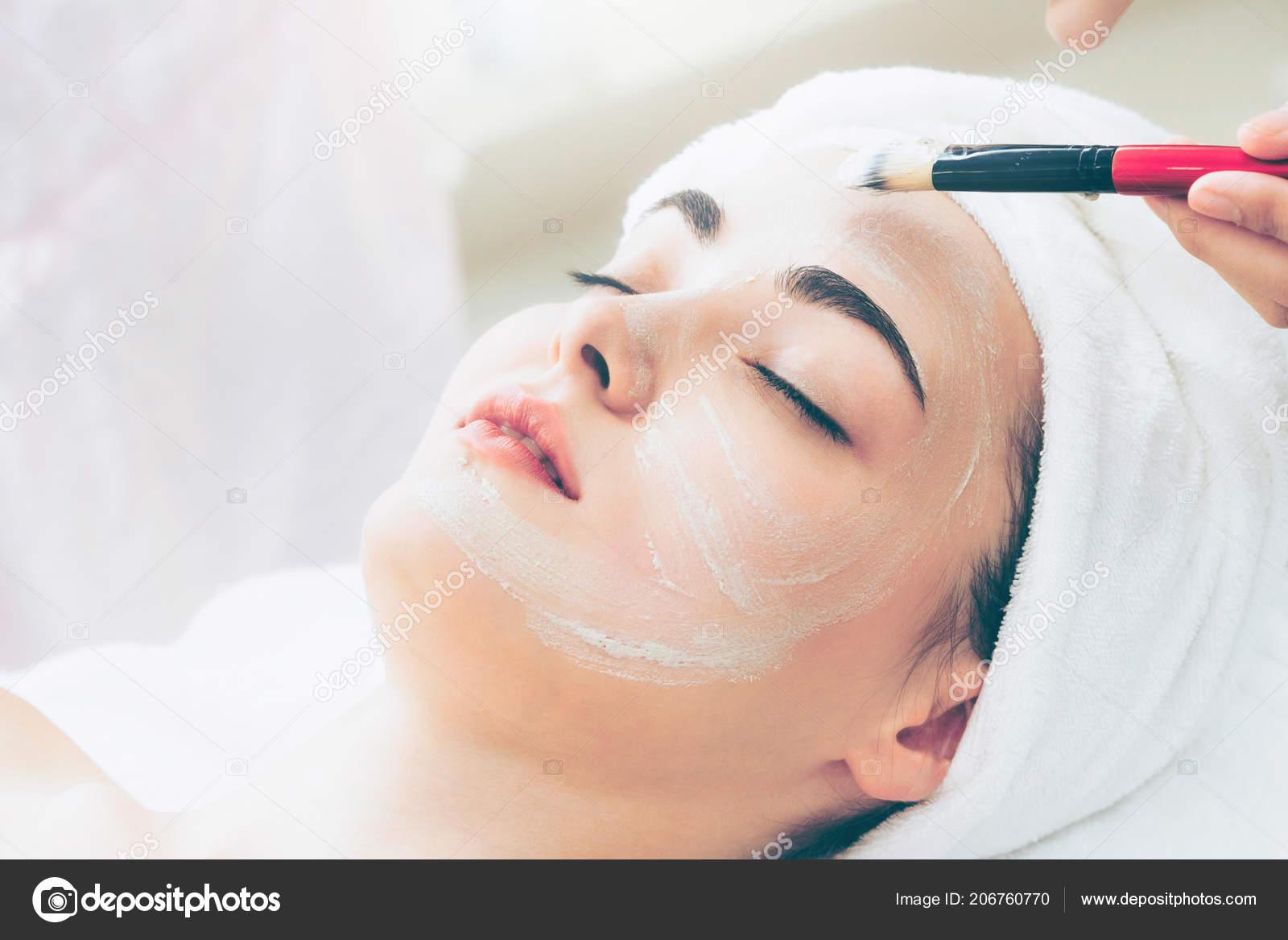 Beautiful Woman Having Facial Cosmetic Scrub Treatment