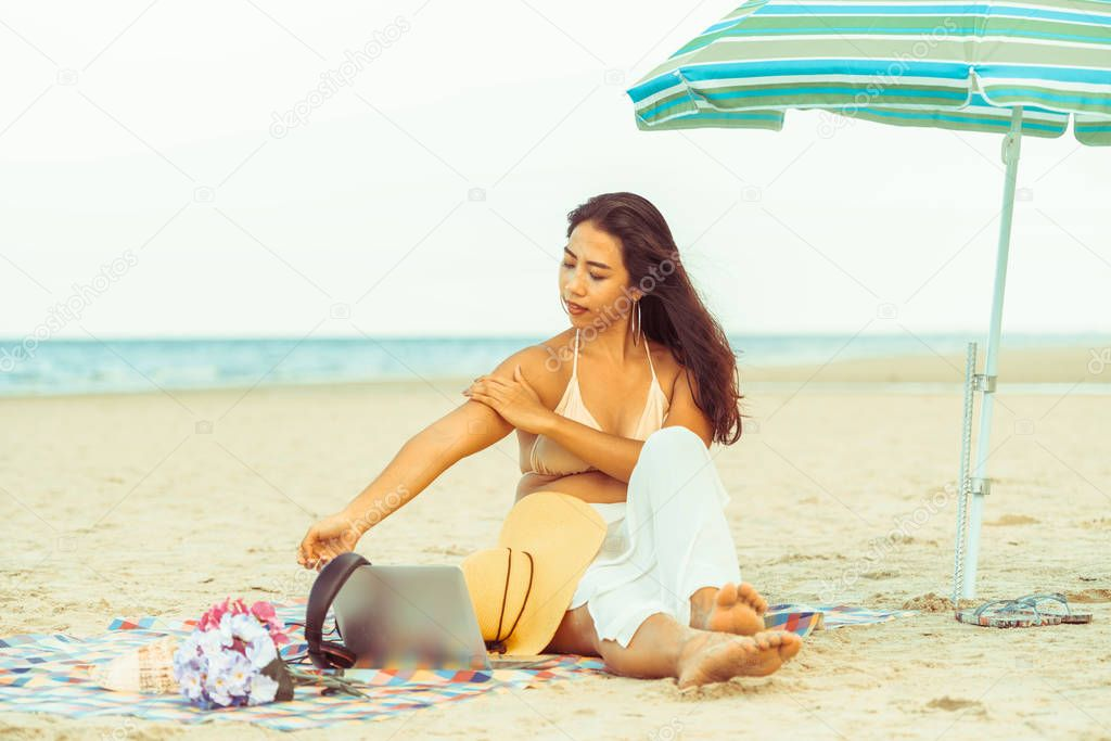 Plus size young woman sitting on tropical sand beach in summer. Holiday travel vacation.