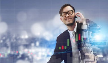 Double exposure image of businessman using mobile phone with modern business buildings and cityscape in the background. Digital innovation and technology disruption concept.