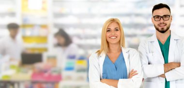 Pharmacist working with another pharmacist in the pharmacy. Healthcare and medical service.