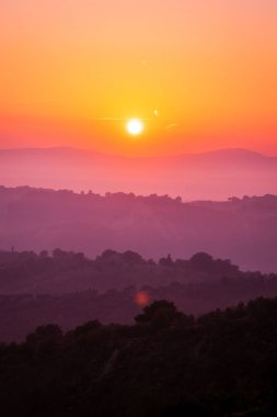 Beautiful sunrise overlooking mountain landscape in the summer morning.