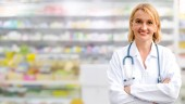 Senior woman pharmacist working in the pharmacy. Medical healthcare and medicine service.