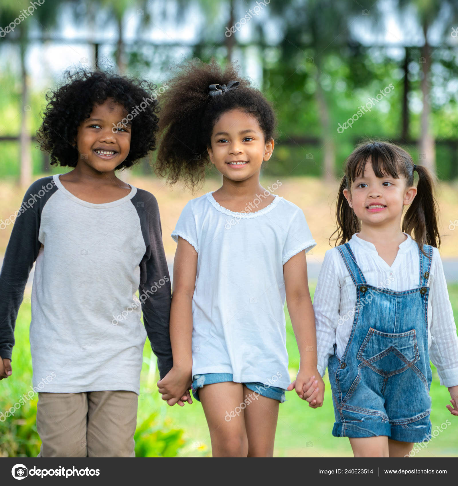 Happy african american boy girl kids group playing playground school stock photo
