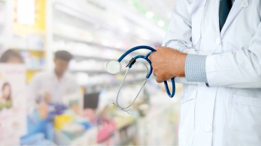 Senior male pharmacist working at the pharmacy. Medical healthcare and pharmaceutical service.