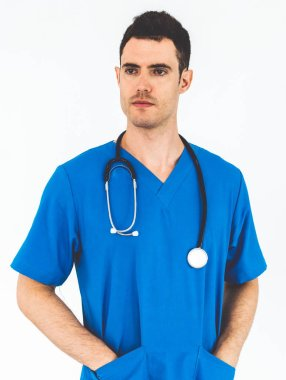 Male doctor in hospital uniform standing on white background. Healthcare and medical concept.