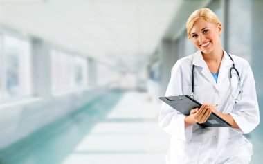 Woman doctor working at the hospital office.