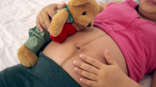 Happy pregnant woman sleeping on bed in bedroom.