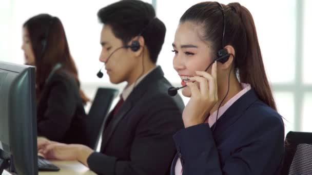 Business people wearing headset working in office