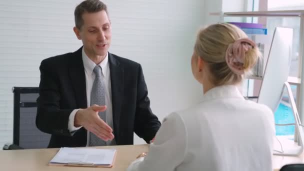 Job seeker and manager handshake in job interview