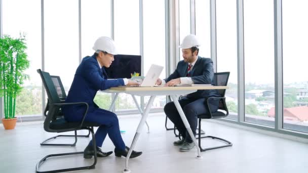 Engineer and architect meeting at office table