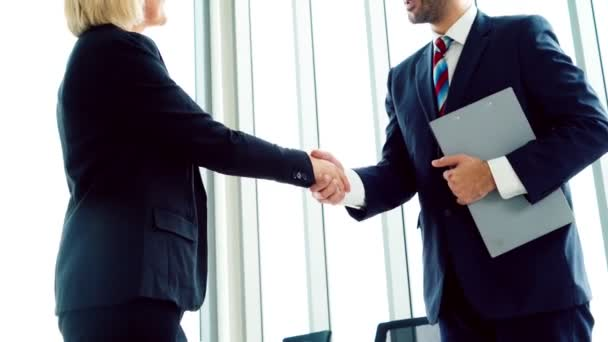 Business people handshake with friend at office