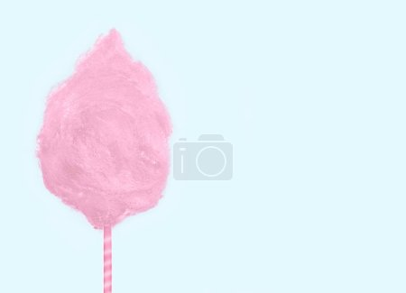 Photo for Sweet pink cotton candy isolated on soft mint green background. - Royalty Free Image