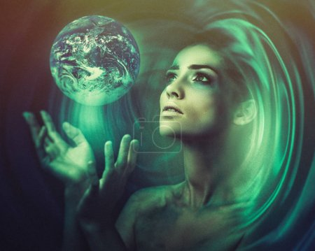 Photo for Blue Earth in hands, Birth of new universe, fantastic female portrait. - Royalty Free Image