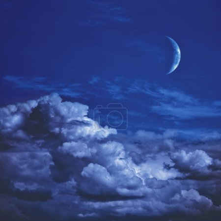 Photo for Natural night background with dark blue sky, young moon and clouds. - Royalty Free Image