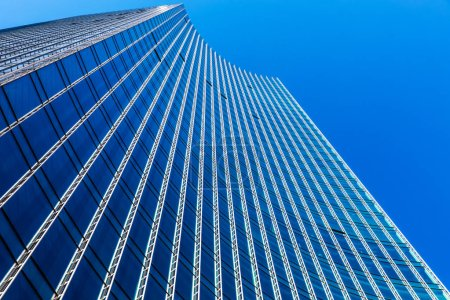 Photo for Downtown corporate business district architecture concept: high angle view of the glass reflective office building skyscraper against blue sky - Royalty Free Image