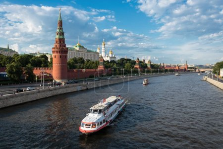 Photo for MOSCOW, RUSSIA - JUNE 3, 2018: View of river Moscow with walking ship, Kremlevskaya Embankment and towers of Kremlin - Royalty Free Image
