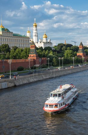 Photo for MOSCOW, RUSSIA - JUNE 3, 2018: View of river Moscow with ship and Kremlevskaya Embankment and towers of Kremlin - Royalty Free Image