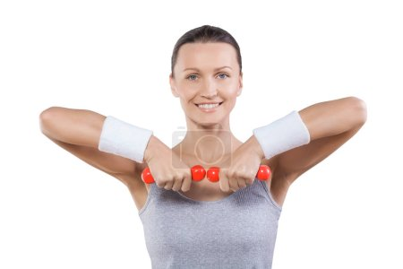 close up portrait sport woman with little red dumbbells looking